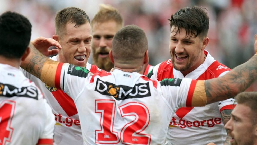 Gareth Widdop celebrates with Joel Thompson .